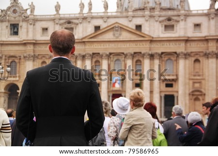 ROME - MAY 1: Unidentified jesuit father listening the mass on Saint Peter's Square during the celebration for the John Paul II beatification on May 1,2011 in Rome - stock photo