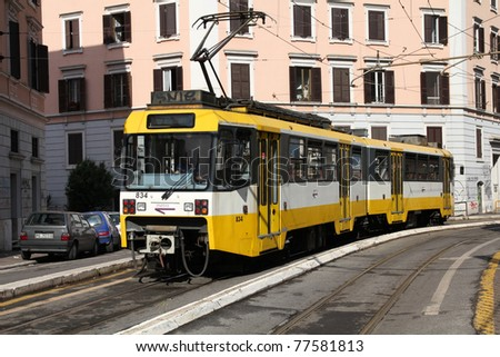 ROME - MAY 12: Yellow tram on May 12, 2010 in Rome, Italy. The tram (officially railway) is operated by Rome Metro, which has an annual ridership of 331 million passengers (2008, 32nd worldwide).