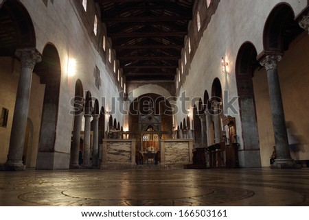 ROME - NOVEMBER 13: The  romanesque interior of Santa Maria in Cosmedin on November 13, 2013 in Rome, Italy. Santa Maria in Cosmedin is a Byzantine Rite and one of the most interesting church in Rome - stock photo