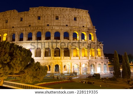 ROME - OCTOBER 31: Coliseum exterior on October 31, 2014 in Rome, Italy. The Coliseum is one of Rome's most popular tourist attractions with over 5 million visitors per year.