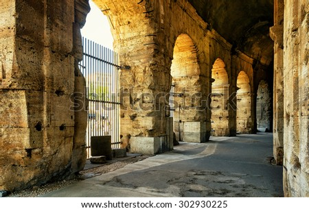 ROME - OCTOBER 4, 2012: Inside the Colosseum (Coliseum). The Colosseum is a major tourist attraction in Rome. - stock photo