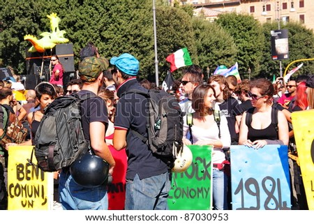 ROME - OCTOBER 15 - People (200k) protest against the anti-crisis program of the government during the worldwide demonstration linked to Occupy Wall Street on October 15, 2011 in Rome - stock photo
