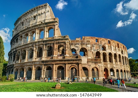 Rome - October 4, 2012: Tourists visit the Colosseum (Coliseum), Italy. Roman Colosseum is one of main travel attractions. Scenic view of Colosseum on a sunny day. Colosseum in the sunlight.