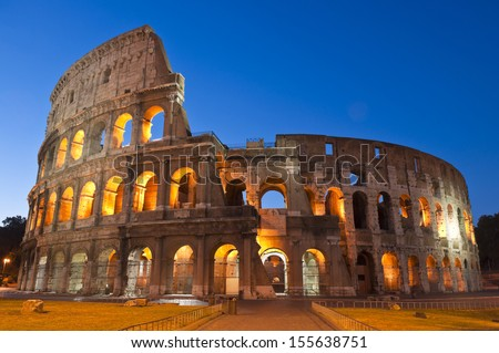 Rome's mighty Coliseum (AD 80), illuminated at night and icon of the city, still standing today as a testament to ancient engineering. - stock photo