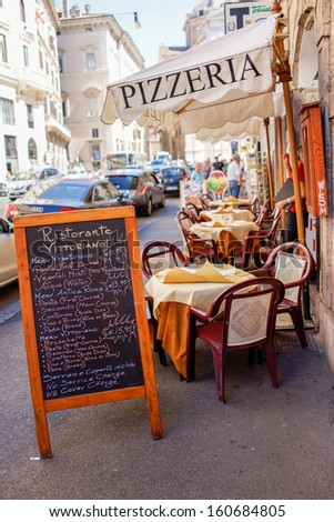 ROME - SEP 20: Italian Pizzeria on September 20th 2013,in Rome Italy. There is a bill before the Italian Parliament to safeguard the traditional Italian pizza by specifying ingredients and methods. - stock photo