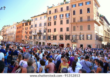 ROME - SEPTEMBER 18: Crowd in Piazza di Spagna on September 18, 2011 in Rome. Piazza di Spagna with its fountain and Spanish Steps is among most iconic squares worldwide.