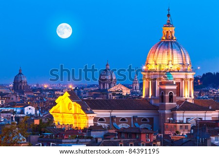 Rome Skyline at night. In the foreground San Carlo al Corso Church. - stock photo