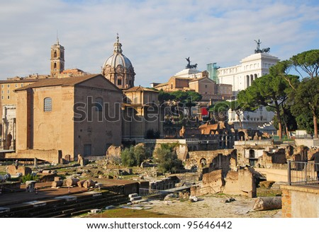 Rome, the Roman Forum with The Curia Julia and the National Monument to Victor Emmanuel II in the bottom - stock photo