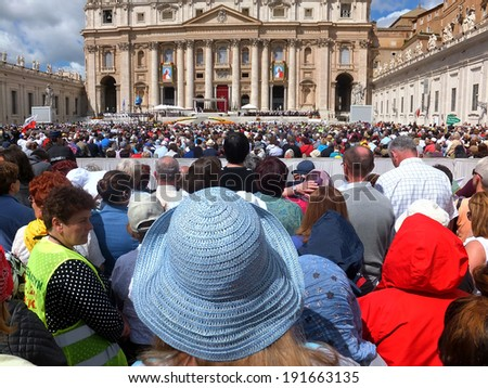 ROME, VATICAN - April 28, 2014: polish pilgrims listen to the mass during the canonization John Paul II and John XXII  on 28 April 2014 - stock photo