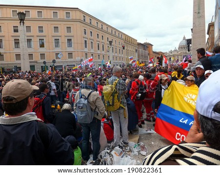 ROME, VATICAN - April 27, 2014: St. Peter's Square, a celebration of the canonization of Popes John Paul II and Pope John XXIII, were canonized by Pope Francis, on 27 April 2014. Great joy,  - stock photo