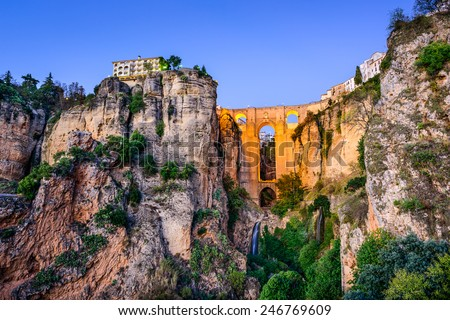 Ronda, Spain at Puente Nuevo Bridge at dusk. - stock photo