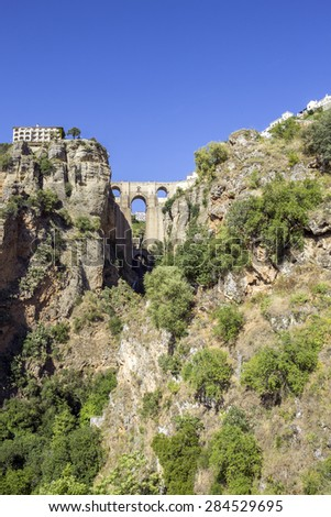 Ronda view. A city in the Spanish province of Malaga, within Andalusia. Situated in a mountainous area about 750 m above mean sea level. The Guadalevin River runs through the city, dividing the ciity - stock photo