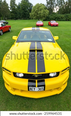 "RONNEBY, SWEDEN - AUGUST 09: Summer V8 car fans event ""Pony & muscle car meet"". Front and up view of Ford Mustang model 2005 in 08 August, 2014 in Ronneby, Sweden. - stock photo"