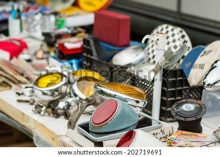 RONNEBY, SWEDEN - JUNE 28, 2014: Nostalgia Festival with classic cars and motorcycles as main attractions. Some old, used stuff on sale at market.
