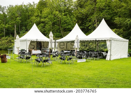 RONNEBY, SWEDEN - JUNE 28, 2014: Nostalgia Festival with classic cars and motorcycles as main attractions. The VIP tent before guests arrive.