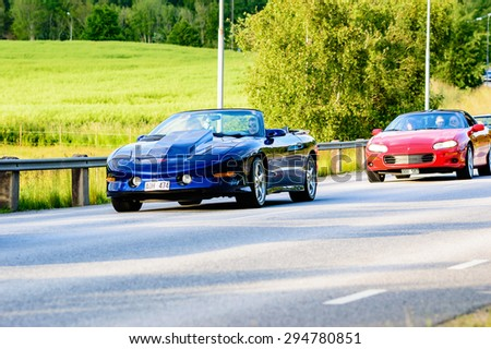 RONNEBY, SWEDEN - JUNE 26, 2015: Veteran car street cruise on public roads. Pontiac Trans am 1995.