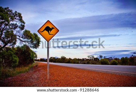 Roo Sign. A typical scene when driving in the outback in Australia warning of Kangaroos crossing the road. - stock photo