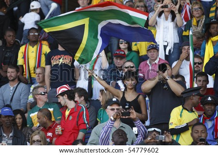 ROODEPOORT, SOUTH AFRICA - JUNE 5:  Spectators in stands at an an international soccer friendly between the USA and Australia ahead of the 2010 World Cup June 5, 2010 in Roodepoort, South Africa. - stock photo