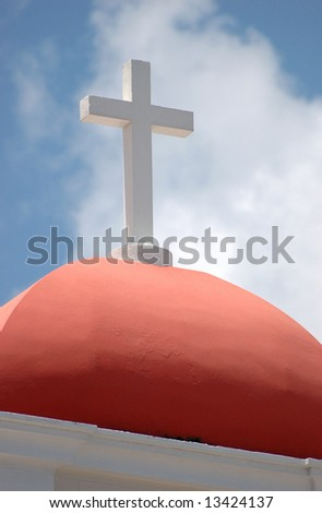 Roof and cross atop a small building at Castillo El Morro in San Juan, Puerto Rico - stock photo