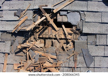 Roof construction site. Removal of old roof, replacement with new shingles, equipment and repair. Roofs are a very important part of all housing projects around the world.  - stock photo