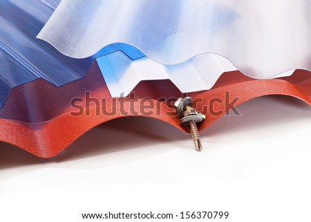 Roof covering made of polycarbonate in different shapes and colors and screws - stock photo
