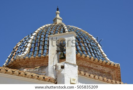 Roof dome and bell on the Monastery of Saint Michael (Real Monasterio de San Miguel) in Lliria near Valencia, Spain