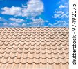 Roof from a against the blue sky - stock photo