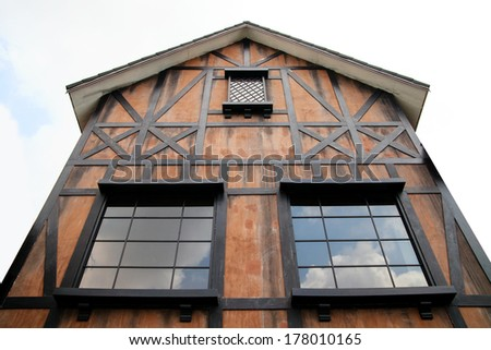 Roof gable and window of the wood house.  - stock photo