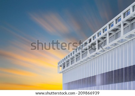Roof gutter of factory with clear sky background. - stock photo