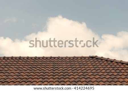 Roof house with orange tile roof on blue sky