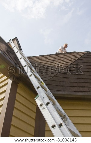 Roof inspector check for damage after recent wind storms, many roofs were damaged - stock photo