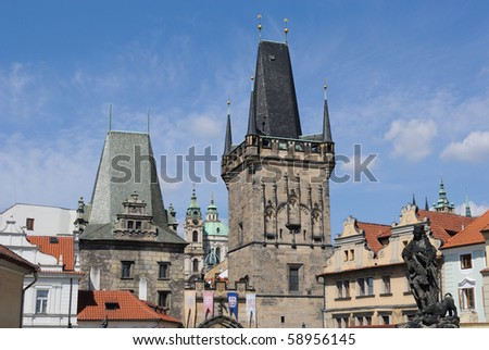 Roof line including Charles Bridge Tower in Prague, Czech Republic.