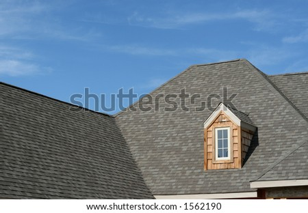 roof-line on new home - stock photo