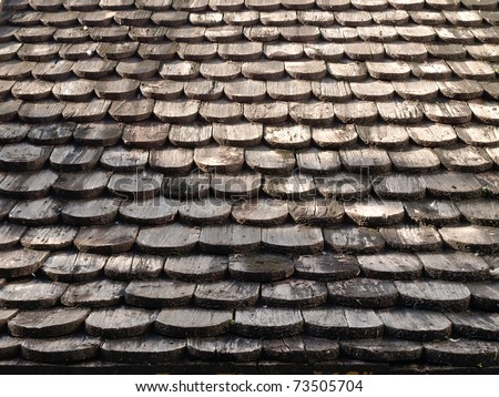 Roof made ??of wood. Close Up Wooden Tile Background - stock photo