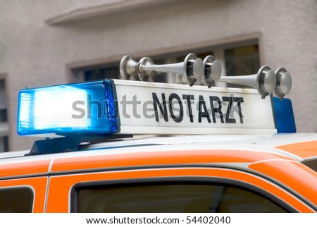 roof of a german emergency car with blue light - stock photo