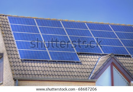 roof of a house covered with solar panels - stock photo