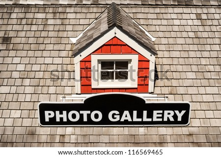 """Roof of a house with window and sign """"Photo gallery"""" - stock photo"""