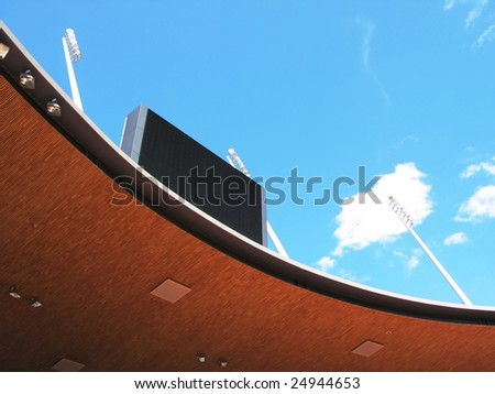 Roof of a stadium and scoreboard - stock photo