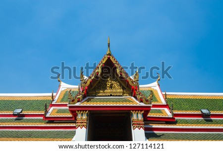 Roof of temple of thailand with blue sky.