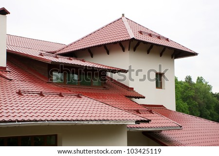 Roof of the house, lined with red roof tiles - stock photo