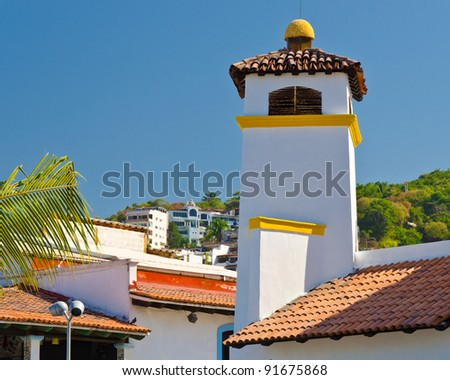 Roof of the house under blue sky in Puerta Vallarta, Mexico - stock photo