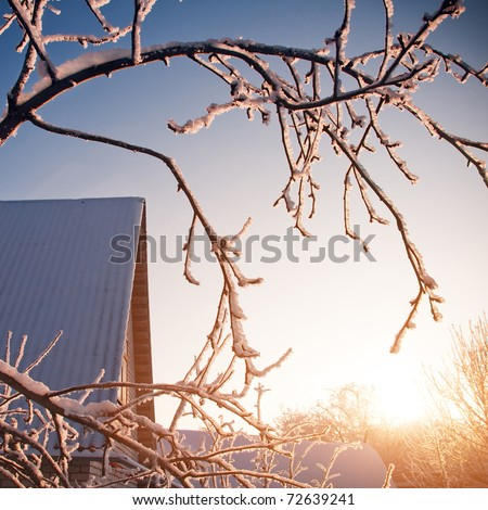 Roof of village house in the rays of evening sun - stock photo