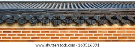 roof on wall in Gyeongbokgung palace ,Korea - stock photo