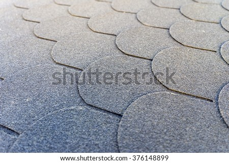 Roof shingles on a roof / Roof shingles - stock photo