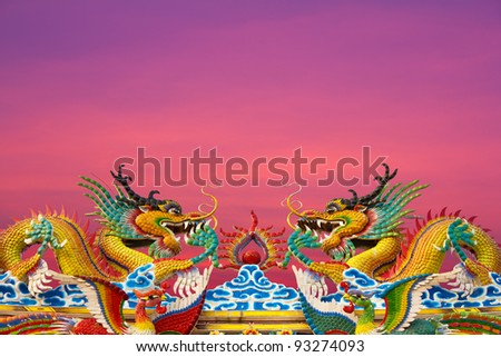 Roof sky dragon. Golden Dragon statues, two on the roof gracefully.