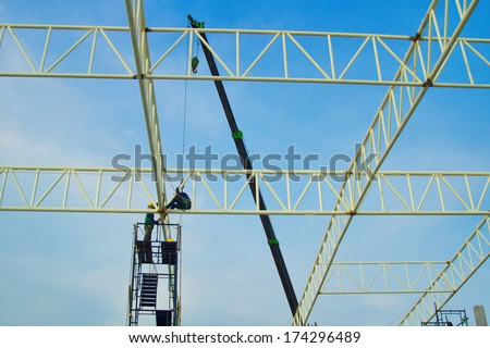 Roof structure be constructing with manpower and mobile crane. - stock photo
