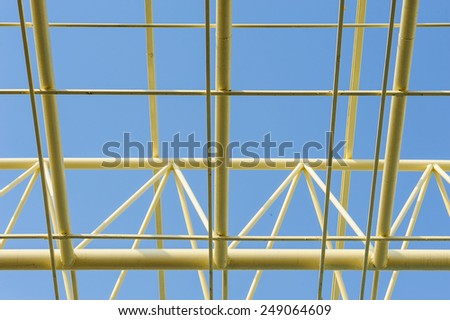 Roof sturcture made from steel in the blue sky - stock photo