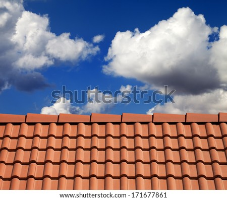 Roof tiles and cloudy sky at nice sun day - stock photo