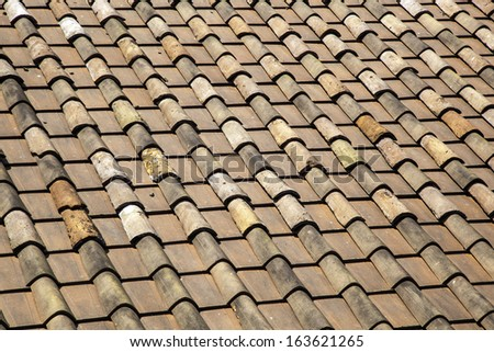 Roof tiles of an old building - stock photo