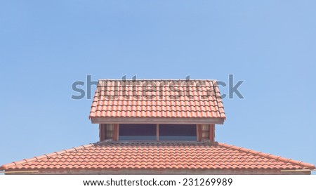 Roof tiles under clear blue sky - stock photo